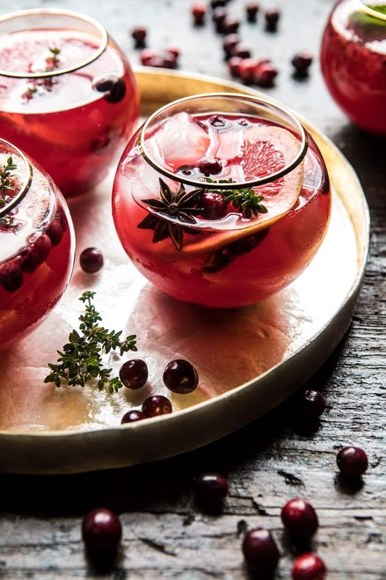 Cranberry Thyme Spritz: uses elderflower liquor, sweetened with honey, hints of thyme, extra festive + pretty...perfect holiday drink! @halfbakedharvest.com