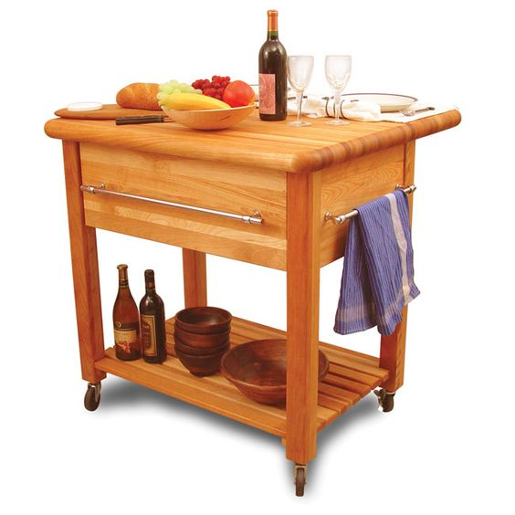 Give yourself more workspace in the kitchen with this stylish wooden kitchen cart that features butcher block styling. This heavyweight table is crafted from solid wood for durability and is equipped with a storage drawer for holding kitchen essentials.