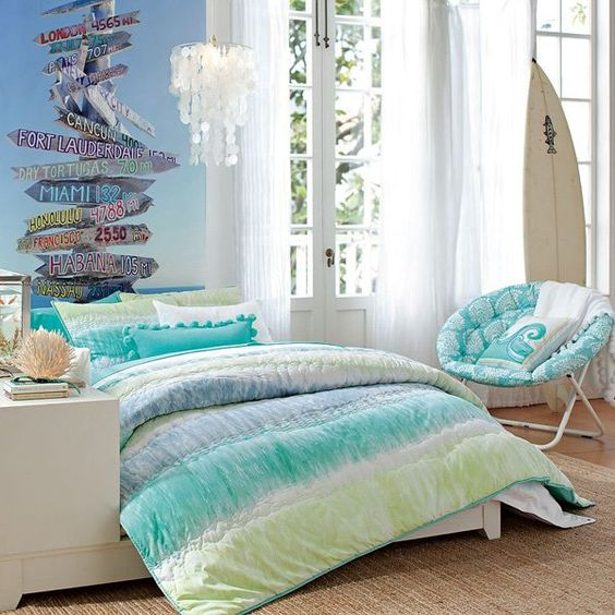 A mother-of-pearl chandelier, plus blue and green duvet with a comfortable looking lounge chair is perfect for any teenage girl who lives by the sea. And partner the surfing board with a wave-design pillowcase.