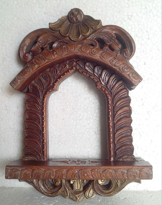 Seem to be a large number of these on ebay ..regardless antique or not i love it ..old rajasthan jharokha wood carving picture frame emboss painting Home art India