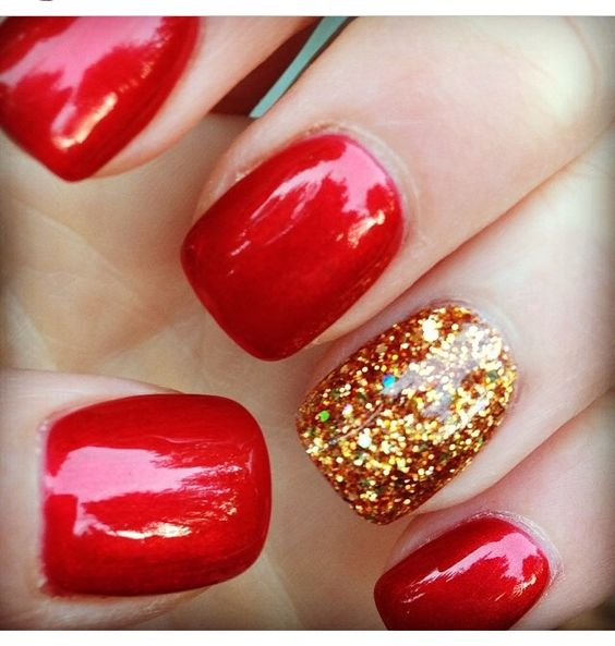 Red nails with sparkly gold. Fall nails