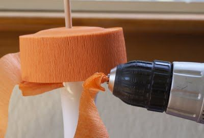 make twine with a drill and crepe paper.... if nothing else it'd be fun :)