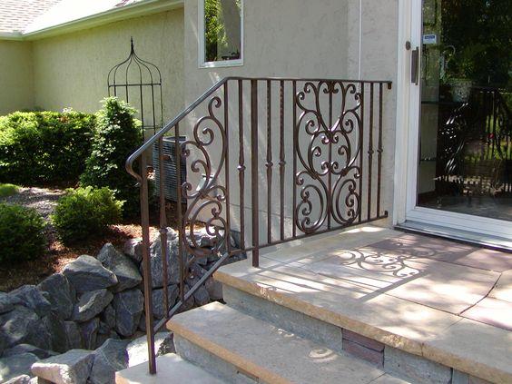 Iron step railing with Tuscan design