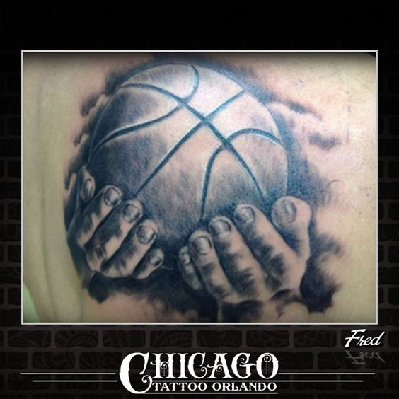 Basketball tattoo with hands