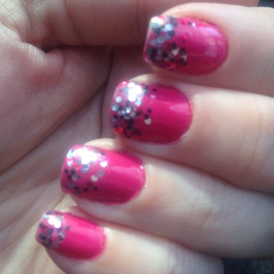 My hot pink nails with silver, black, and hot pink glitter. I think it looks like confetti on my fingertips.