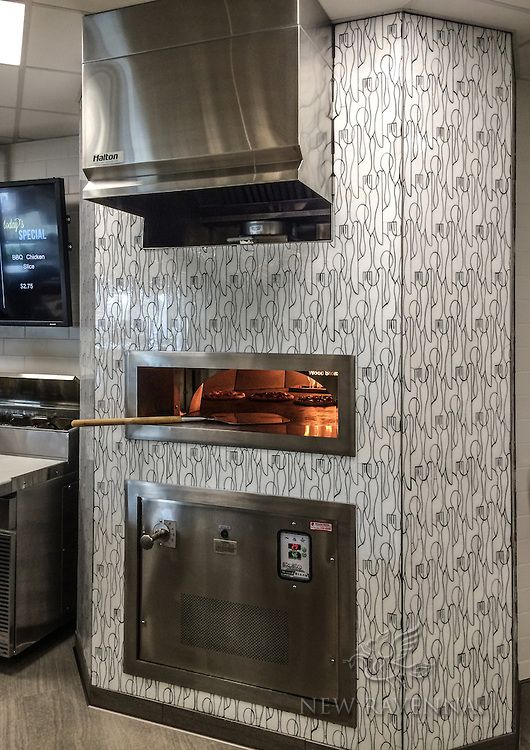 This custom commercial pizza oven features Forks Knives and Spoons, a handmade mosaic shown in Moonstone jewel glass from the Erin Adams Collection for New Ravenna Mosaics