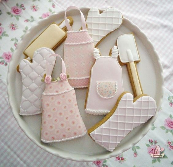 Kitchen or baking themed decorated cookies by Sweetopia - rolling pin, spatula, oven-mits, and vintage aprons in pink pastels. Sweet.