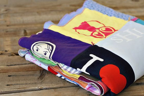 Excellent tutorial on how to make recycled t-shirt Quilts~ (great memory gift idea if you use your kid's shirts through the years)