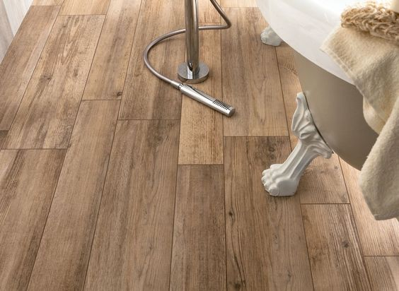 rather intrigued by these wood effect ceramic floor tiles. medium rough wooden floor tiles in bathroom closeup