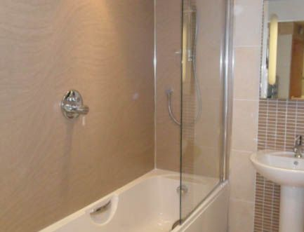 Waterproof wall panels bathroom wall panels and tiling on for Bathroom wall cladding ideas