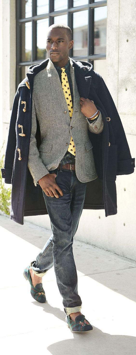 Shop this look on Lookastic:  http://lookastic.com/men/looks/tassel-loafers-jeans-belt-blazer-duffle-coat-tie-long-sleeve-shirt/9010  — Navy and Green Plaid Canvas Tassel Loafers  — Navy Jeans  — Brown Leather Belt  — Grey Herringbone Wool Blazer  — Navy Duffle Coat  — Yellow Print Tie  — Navy and Green Plaid Long Sleeve Shirt