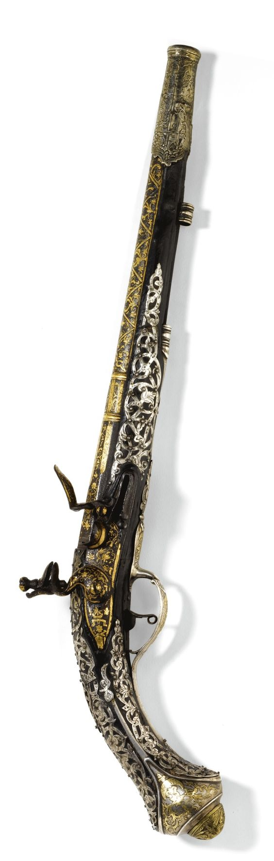 An Ottoman silver-mounted pistol with earlier gold-inlaid barrel, Turkey, circa 1700