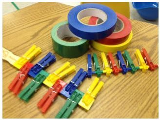 Squeezing and Placing Clothespins for Strengthening and Color Matching: