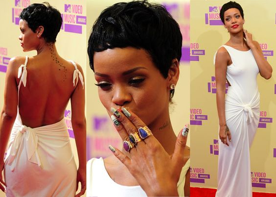Rihanna stole the show at the MTV Video Music Awards as she showed off a toned back, complete with a star tattoo trailing down, in a white Adam Selman dress. The singer, who opened the evening by performing her new song Cockiness, also revealed her new pixie do.