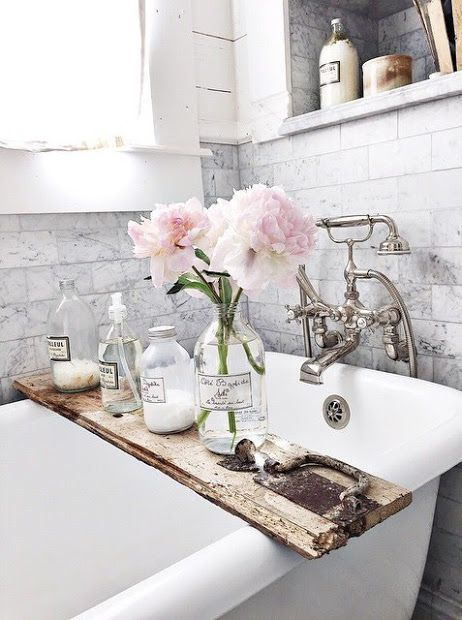 Marble subway tile with claw footed tub in this beautiful bathroom ...