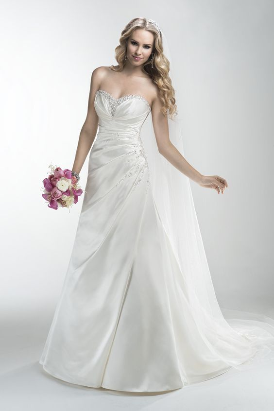 Gown by Maggie Sottero