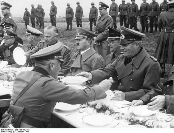 Hitler having a meal with German Army officers on the side of the road between Franzensbad and Eger, Sudetenland, Germany, 3 Oct 1938.