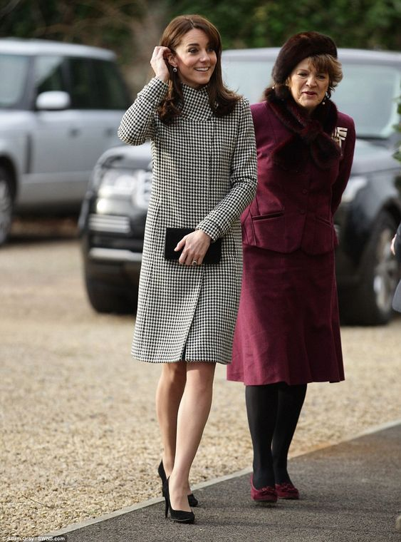 When the Duchess of Cambridge arrived at the centre, she hid her bold dress beneath this R...