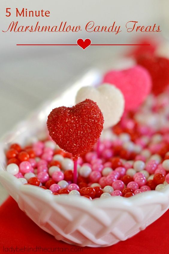 5 Minute Marshmallow Candy Treats are heart shaped, strawberry flavored marshmallows dipped in melted candy and sprinkles. One taste and you will swear yo