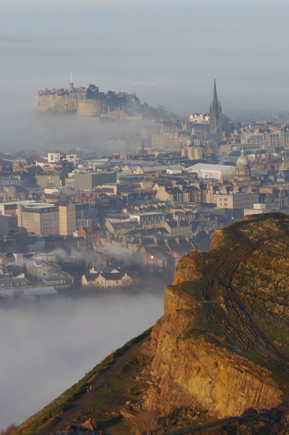 Edinburgh emerging from morning fog, taken from Salisbury Crags.: