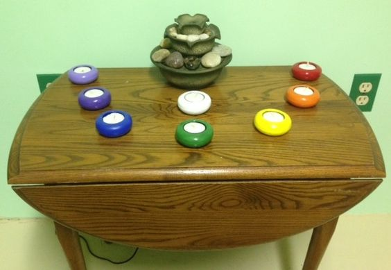 My daughter painted tealight candle holders in chakra colors for my Reiki room.