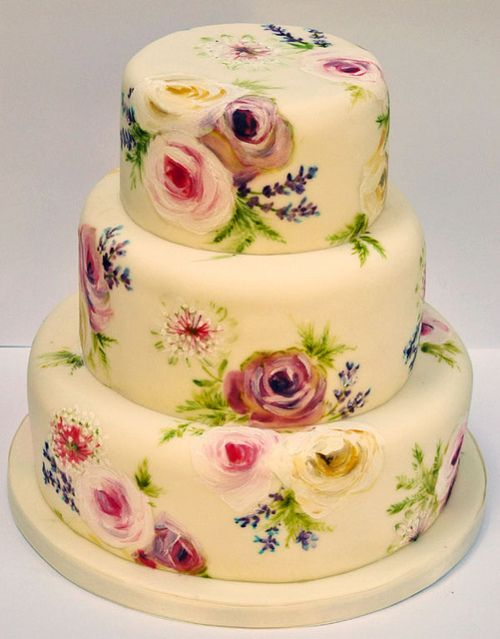 A painted tiered fruit cake with old dutch roses, lavender, astrantia and ferns.