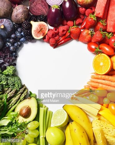Stock Photo : Spectrum of fruit & veg forming a heart shape