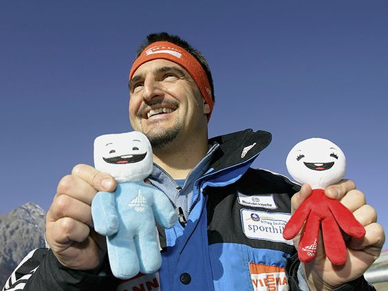 Georg Hackl of Germany poses for the media during the training session with the Olympic mascots just prior to the Torino 2006 Winter Games in Italy. (Photo by Friedemann Vogel/Bongarts/Getty Images)