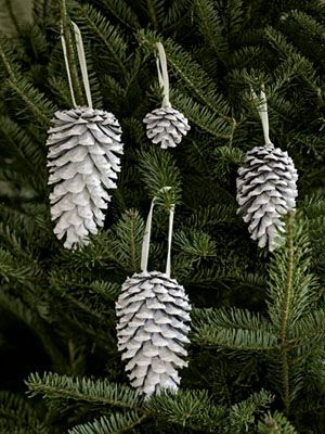 White Spray-painted pinecones really pop against evergreen boughs. DIY Christmas tree decorations
