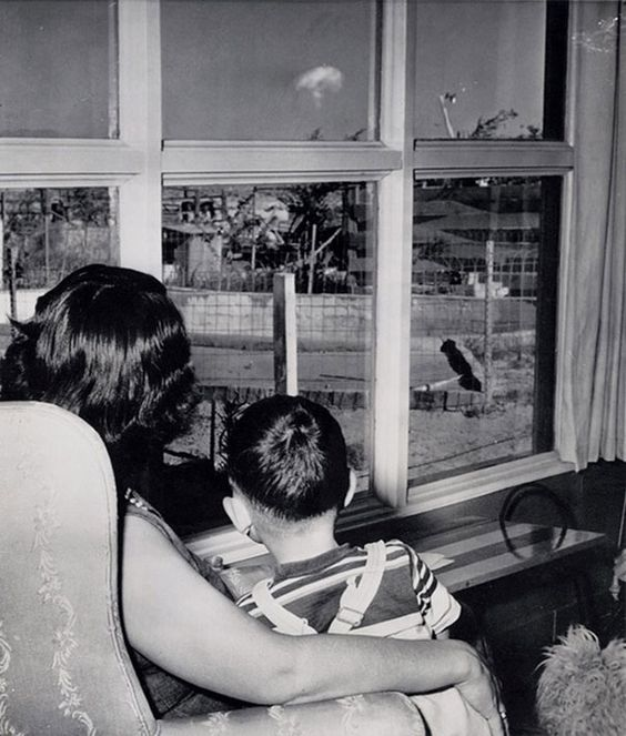 Mom and son watching mushroom cloud after atomic test, Las Vegas 1953