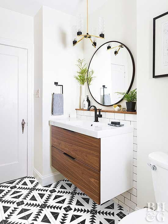 Modern Bathroom With Round Mirror And Single Sink Cabinet Note This Is An Ikea Floating Vanity Modern Bathroom Mirrors Modern Bathroom Bathroom Mirror Cabinet