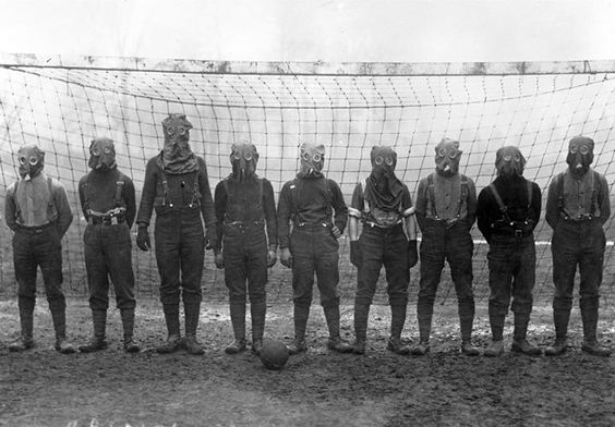 British soldiers play football while wearing gas masks France 1916 [1247x869] #HistoryPorn #history #retro http://ift.tt/1qjaE6Q