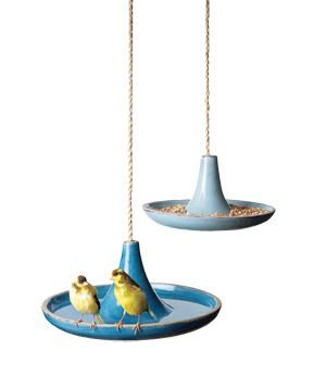 Large Glazed Terracotta Bird Feeder    Sweet terracotta perches, so the two lovebirds can live happily ever after.    To buy: $116, popdeluxe.net.: