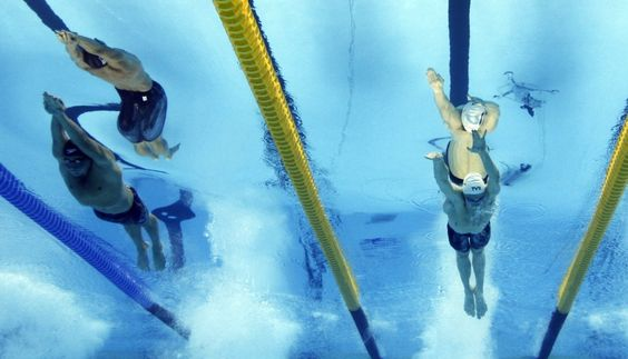 Ryan Lochte (L) of the U.S. and France's Yannick Agnel compete in the men's 200m freestyle final at the 14th FINA World Championships in Shanghai July 26, 2011.
