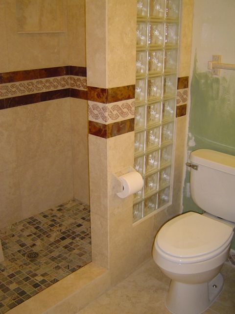 this is the building design we would most likely be able to go with would be using grey tones and some kind of scroll pattern on the decorated ti - Bathroom Designs Using Glass Blocks