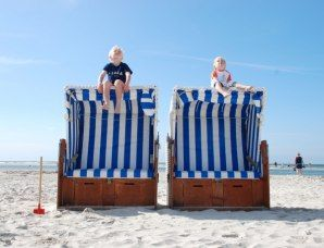 2 kids having fun on top of our famous beach chairs