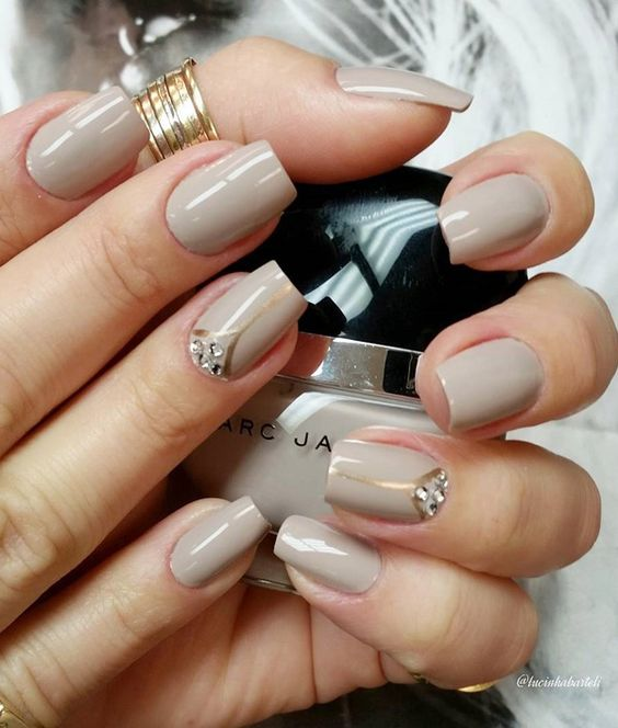Brown gray and gold nail art design. A wonderful looking nail art design with thin gold strips painted on top plus clear beads to add effect.: