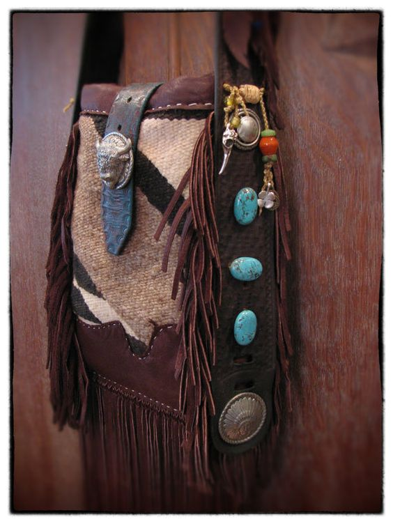 Buffalo in a Blanket, This is a work of functional art. Made of repurposed items like a soft 100% wool saddle blanket with a cotton lining. A 1950's basket tooled bridle and a similar tooled belt for the shoulder strap. Many adornments of glass beads, turquoise stones and a little locket to hold something dear.