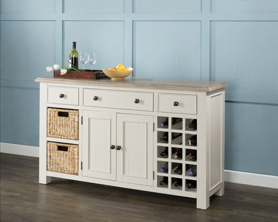 The Portland large sideboard is beautifully painted in antique white and finished with a sundried ash top - http://www.furn-on.com/portland-antique-white-large-sideboard-with-wine-rack-and-baskets.html