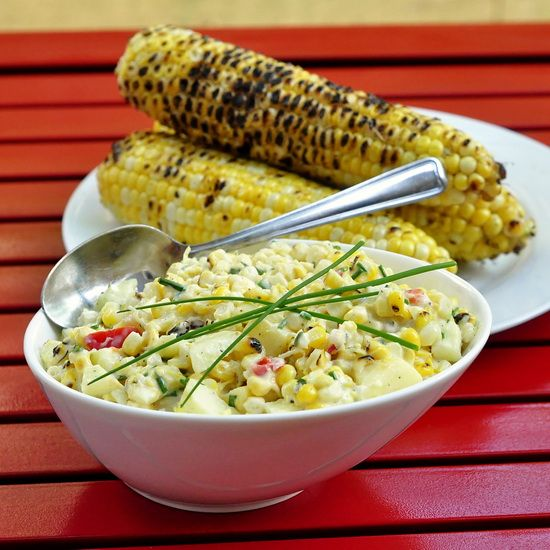 Lemon Chive Grilled Corn Salad - This delicious salad is a summer barbeque staple at our house. Sweet grilled corn, peppers and apples get tossed with an easy to make homemade lemon chive mayo; a terrific, simple but very tasty summer side dish.