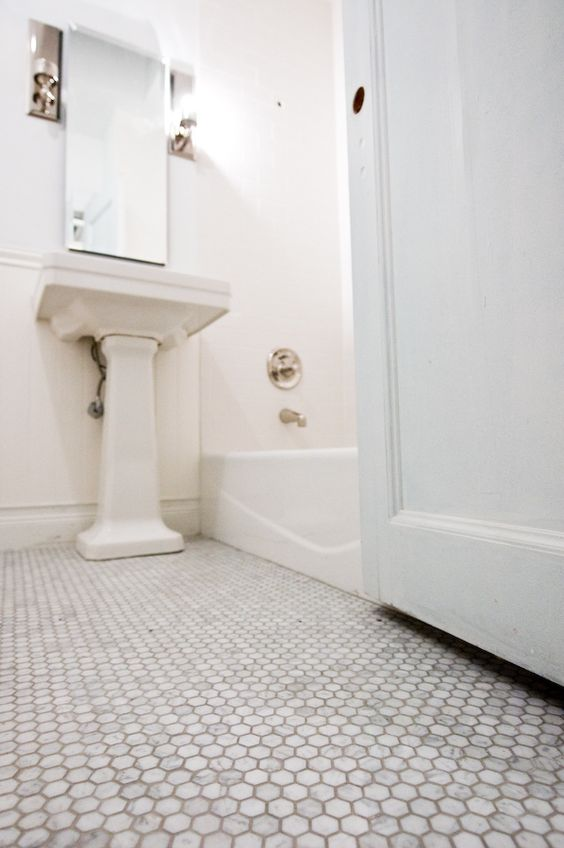 marble hexagon floor tiles with light grey grout (MONDIAL TLES.COM)     maybe use as accent in shower wall