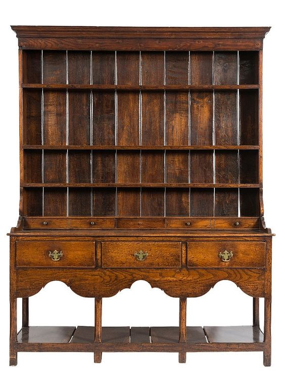 An 18th Century oak dresser:, the shelved superstructure with a moulded cornice and with a single small drawer and four dummy drawers at base, the lower part containing three drawers in the arcaded apron, on chamfered legs, united by a pot board, terminating in block feet, 158cm (5ft 2in) wide, 198cm (6ft 6in) high.