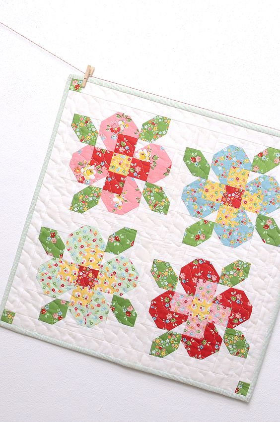 Flower Garden Mini 2 quilt pattern from ellis and higgs made from Nadra Ridgeway's Backyard Roses collection for Riley Blake Designs.
