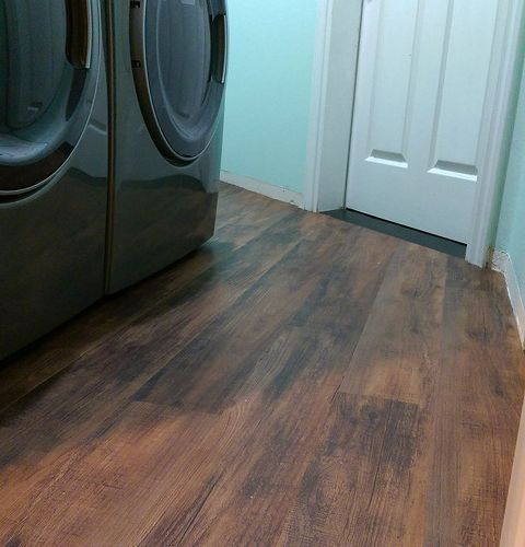 Transform Your Laundry Room Floor With Faux Wood Vinyl Flooring Vinyl Flooring Laundry Room Flooring Wood Vinyl