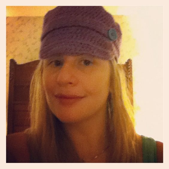 Crocheted hat I made. I used left over purple wool paton yarn and an old button that can easily be changed.
