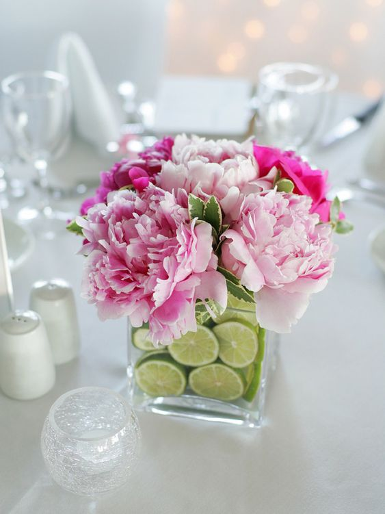 This is a great example of pairing fruit and flowers. Vibrant limes and peonies are a beautiful combination!