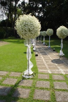 K'Mich Weddings in Philadelphia PA - wedding planning-wedding decor - baby's breath at the walk way with white ribbons on a pole