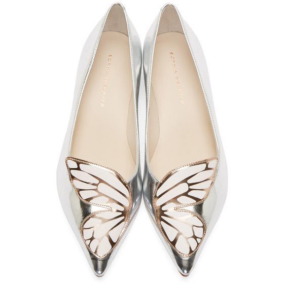Metallic flats in silver.  Pointed toe.  Butterfly wing applique in white and rose gold at toe.  Leather sole.  Tonal stitching.