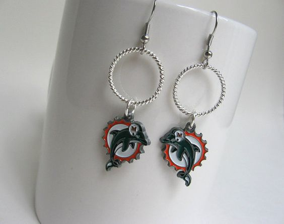 Check out this item in my Etsy shop https://www.etsy.com/listing/259164143/miami-dolphins-football-earringsmiami
