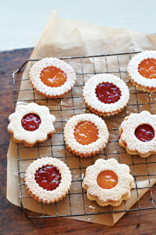 Strawberry Jam Sandwich Cookies I love my thumbprint recipe but these sound good to, and ya know I have LOTS of Jam